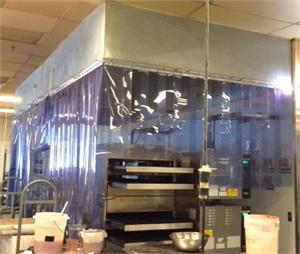 Plastic Strip Curtains Around Oven. PVC Strips for heat control around bakery oven. Plastic Strip Curtain Rolls In Stock.
