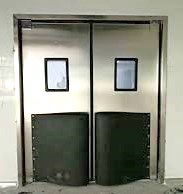 Stainless Steel Traffic Door With Bumpers. Heavy duty stainless steel swinging door for processing rooms.