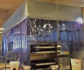 Plastic Strips Around Bakery Oven. PVC Strips for heat control around bakery oven. Plastic Strip Curtains for pizza oven.