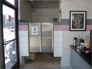 Stainless steel cafe door at Trejos Donuts In Hollywood. Restaurant Kitchen Doors Stainless Swing Doors In Stock.